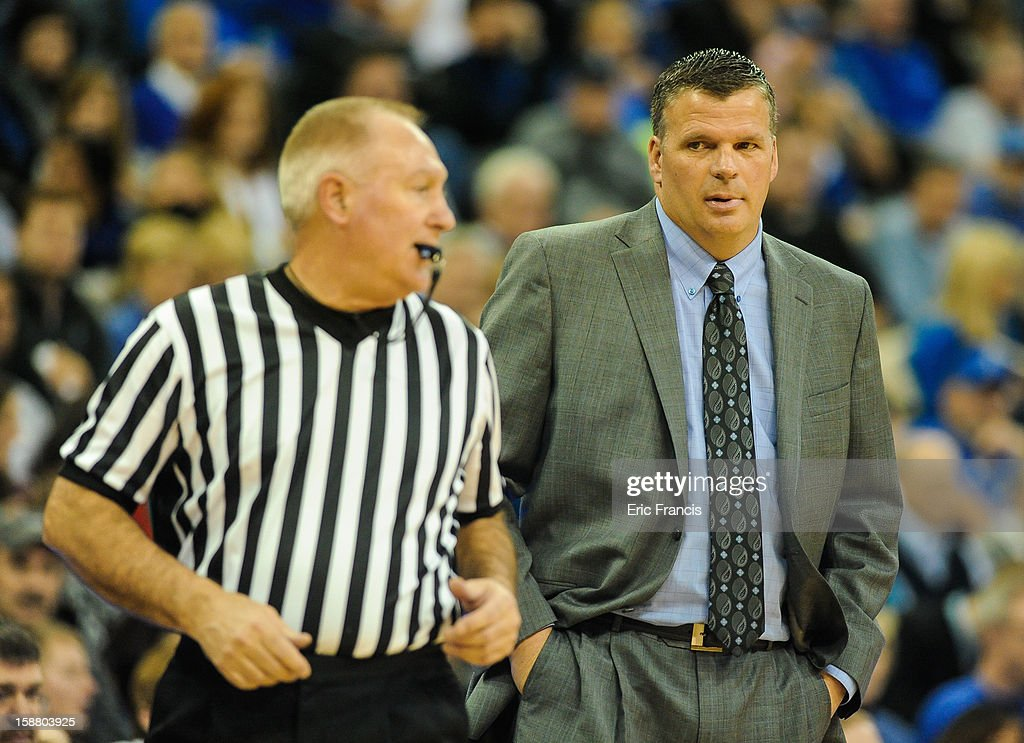 Head coach Greg McDermott of the Creighton Bluejays talk to a referee during their game against the Evansville Aces at the CenturyLink Center on December 29, 2012 in Omaha, Nebraska. Creighton defeated Evansville 87-70.