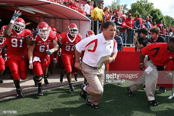 Head coach Greg Schiano of the Rutgers University Scarlett Knights leads his team out of the tunnel against the Norfolk State Spartans at Rutgers...