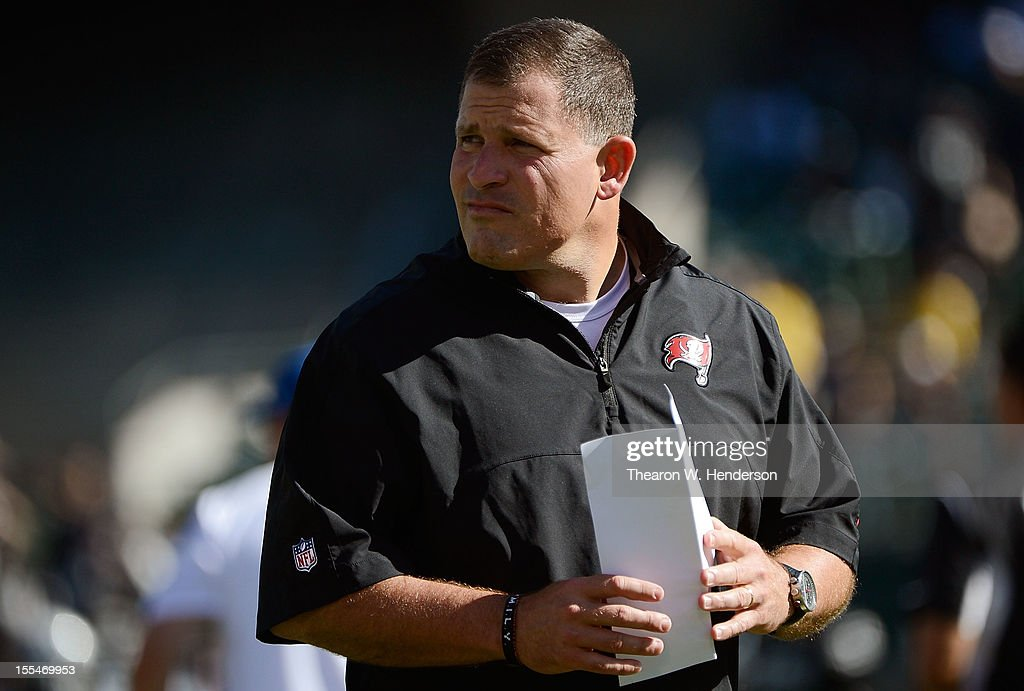 Head coach Greg Schiano of the Tampa Bay Buccaneers looks on while his team warms up during pre-game warm-ups before their NFL football game against the Oakland Raiders at O.co Coliseum on November 4, 2012 in Oakland, California.
