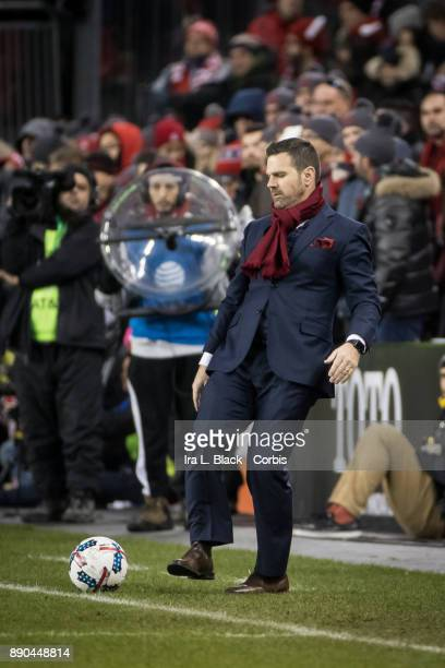 Head Coach Greg Vanney of Toronto FC kicks the ball back in bounds during the 2017 Audi MLS Championship Cup match between Toronto FC and Seattle...