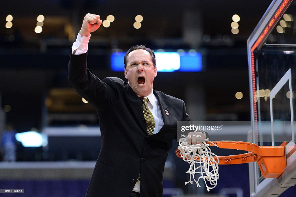 Head coach Gregg Marshall of the Wichita State Shockers celebrates by cutting down the net after defeating the Ohio State Buckeyes 70-66 during the West Regional Final of the 2013 NCAA Men's Basketball Tournament at Staples Center on March 30, 2013 in Los Angeles, California.