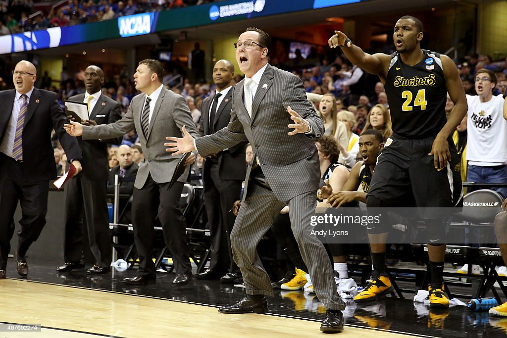 Head coach <a gi-track='captionPersonalityLinkClicked' href=/galleries/search?phrase=Gregg+Marshall&family=editorial&specificpeople=623591 ng-click='$event.stopPropagation()'>Gregg Marshall</a> of the Wichita State Shockers reacts with his bench in the first half against the Notre Dame Fighting Irish during the Midwest Regional semifinal of the 2015 NCAA Men's Basketball Tournament at Quicken Loans Arena on March 26, 2015 in Cleveland, Ohio.