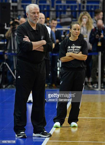 Head Coach Gregg Popovich and Becky Hammon of the San Antonio Spurs look on during practice as part of the 2014 Global Games on October 7 2014 at the...