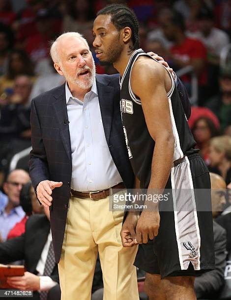 Head coach Gregg Popovich and Kawhi Leonard of the San Antonio Spurs confer as they play the Los Angeles Clippers during Game Five of the Western...