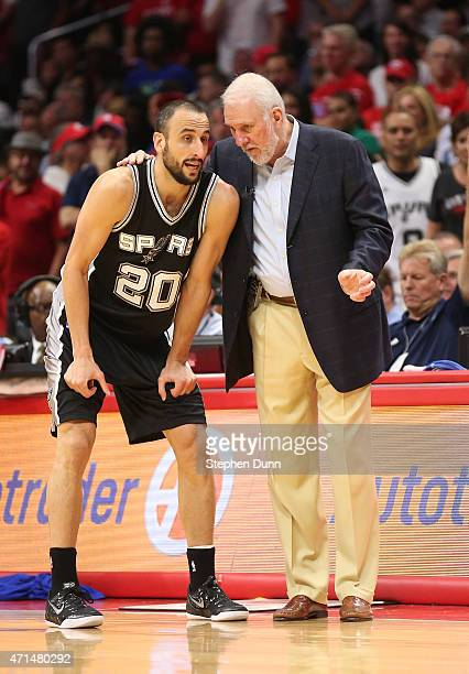Head coach Gregg Popovich and Manu Ginobili of the San Antonio Spurs confer as they play the Los Angeles Clippers during Game Five of the Western...