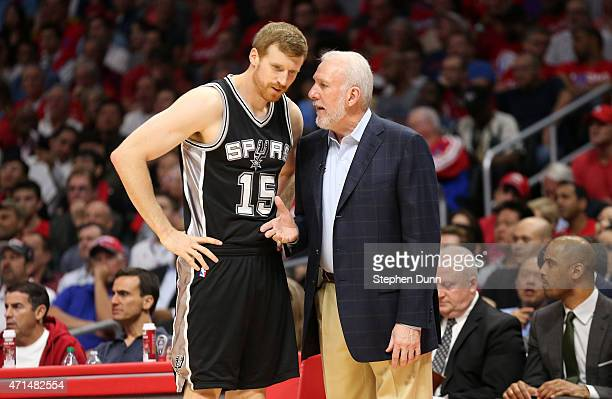 Head coach Gregg Popovich and Matt Bonner of the San Antonio Spurs confer as they play the Los Angeles Clippers during Game Five of the Western...