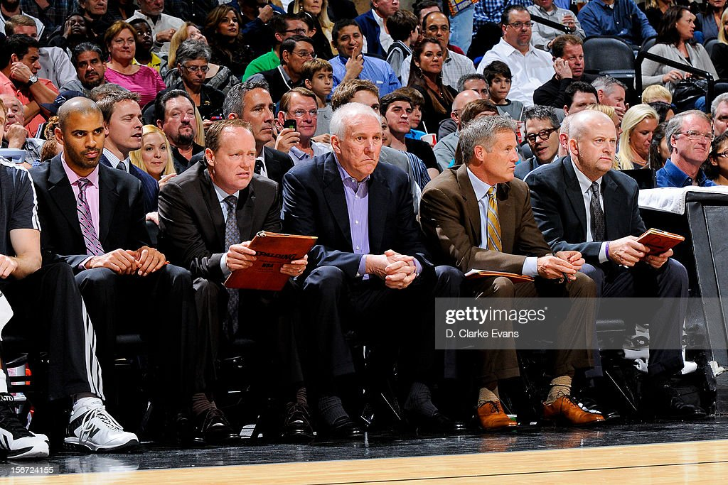 Head Coach Gregg Popovich of the San Antonio Spurs and other members of his coaching staff look on from the bench as their team plays the Los Angeles Clippers on November 19, 2012 at the AT&T Center in San Antonio, Texas.