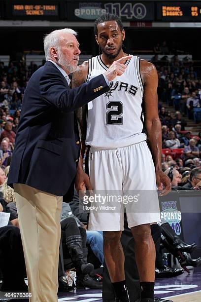 Head Coach Gregg Popovich of the San Antonio Spurs coaches Kawhi Leonard against the Sacramento Kings on February 27 2015 at Sleep Train Arena in...