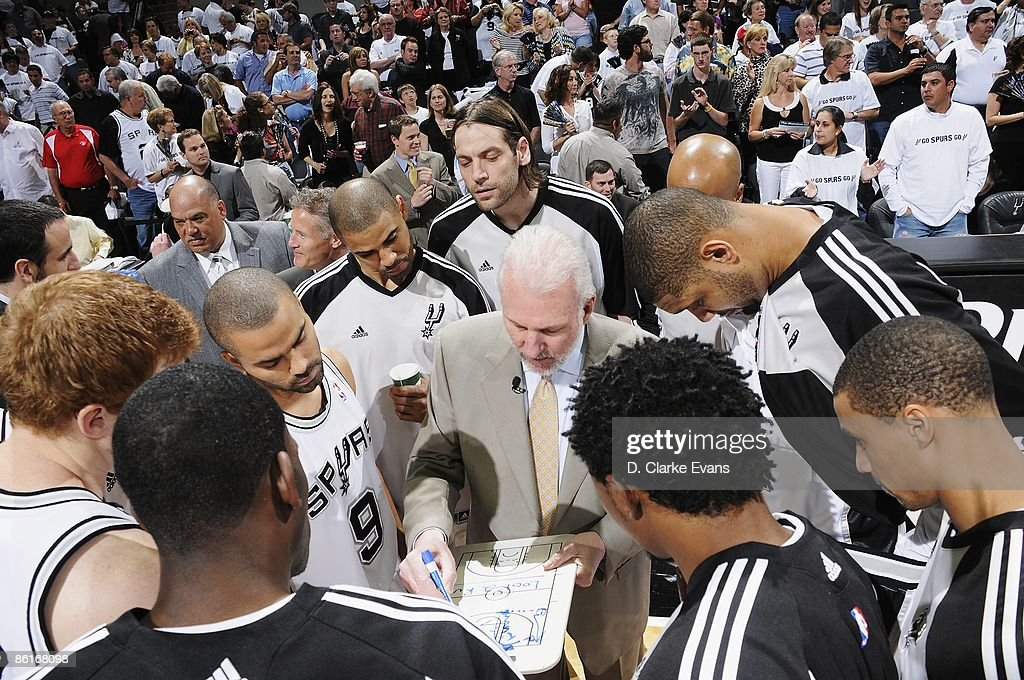 Head coach Gregg Popovich of the San Antonio Spurs draws up a play in the huddle in Game One of the Western Conference Quarterfinals against the Dallas Mavericks during the 2009 NBA Playoffs at AT&T Center on April 18, 2009 in San Antonio, Texas. The Mavericks won 105-97.
