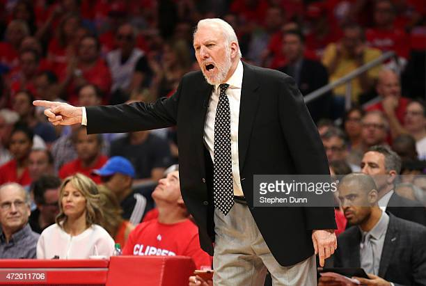 Head coach Gregg Popovich of the San Antonio Spurs gestures against the Los Angeles Clippers during Game Seven of the Western Conference...