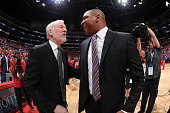Head Coach Gregg Popovich of the San Antonio Spurs greets Head Coach Doc Rivers of the Los Angeles Clippers before Game Seven of the Western...