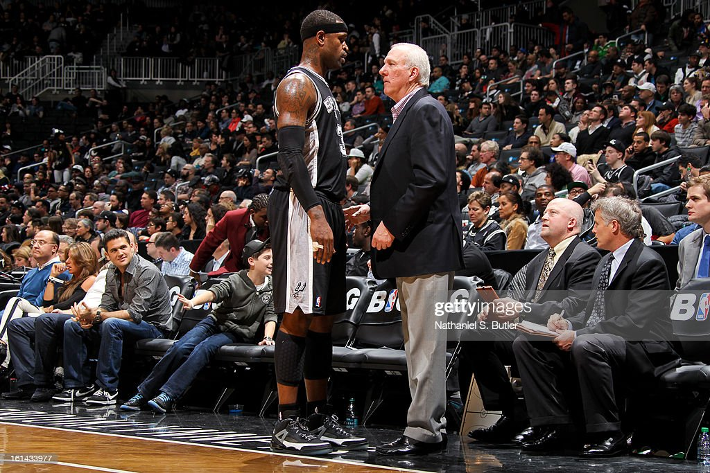 Head Coach <a gi-track='captionPersonalityLinkClicked' href=/galleries/search?phrase=Gregg+Popovich&family=editorial&specificpeople=202904 ng-click='$event.stopPropagation()'>Gregg Popovich</a> of the San Antonio Spurs instructs <a gi-track='captionPersonalityLinkClicked' href=/galleries/search?phrase=Boris+Diaw&family=editorial&specificpeople=201505 ng-click='$event.stopPropagation()'>Boris Diaw</a> #33 during a game against the Brooklyn Nets on February 10, 2013 at the Barclays Center in the Brooklyn borough of New York City.