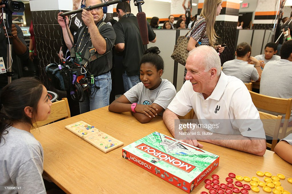 Head Coach <a gi-track='captionPersonalityLinkClicked' href=/galleries/search?phrase=Gregg+Popovich&family=editorial&specificpeople=202904 ng-click='$event.stopPropagation()'>Gregg Popovich</a> of the San Antonio Spurs interacts with the kids at the 2013 NBA Cares Legacy Project as part of the 2013 NBA Finals on June 7, 2013 at the Wheatley Middle School in San Antonio, Texas.