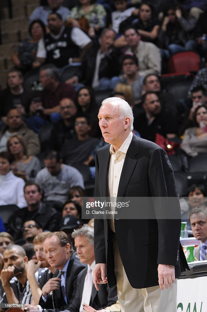 Head Coach Gregg Popovich of the San Antonio Spurs looks out on the court to his players in a game against the Golden State Warriors on January 18, 2013 at the AT&T Center in San Antonio, Texas.