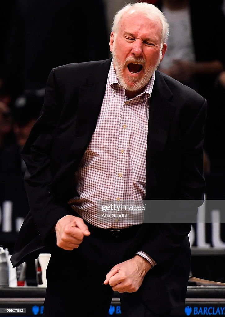 Head coach <a gi-track='captionPersonalityLinkClicked' href=/galleries/search?phrase=Gregg+Popovich&family=editorial&specificpeople=202904 ng-click='$event.stopPropagation()'>Gregg Popovich</a> of the San Antonio Spurs reacts to a foul in overtime during a game against the Brooklyn Nets at the Barclays Center on December 3, 2014 in the Brooklyn borough of New York City.