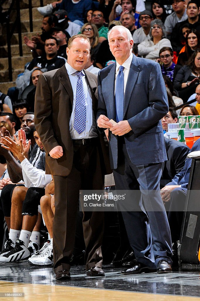 Head Coach Gregg Popovich of the San Antonio Spurs, right, speaks with assistant coach Mike Budenholzer during a game against the New York Knicks on November 15, 2012 at the AT&T Center in San Antonio, Texas.