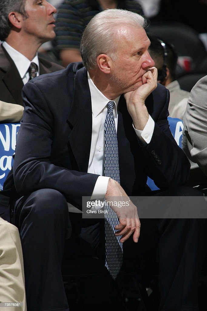 Head coach Gregg Popovich of the San Antonio Spurs sits on the bench during the NBA game against the Denver Nuggets on February 20, 2007 at AT&T Center in San Antonio, Texas. The Spurs won 95-80.