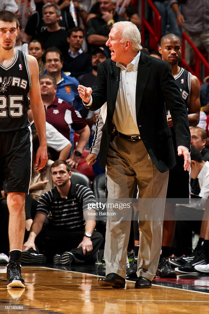 Head Coach <a gi-track='captionPersonalityLinkClicked' href=/galleries/search?phrase=Gregg+Popovich&family=editorial&specificpeople=202904 ng-click='$event.stopPropagation()'>Gregg Popovich</a> of the San Antonio Spurs speaks to Nando de Colo #25 during the fourth quarter of a game against the Miami Heat on November 29, 2012 at American Airlines Arena in Miami, Florida.
