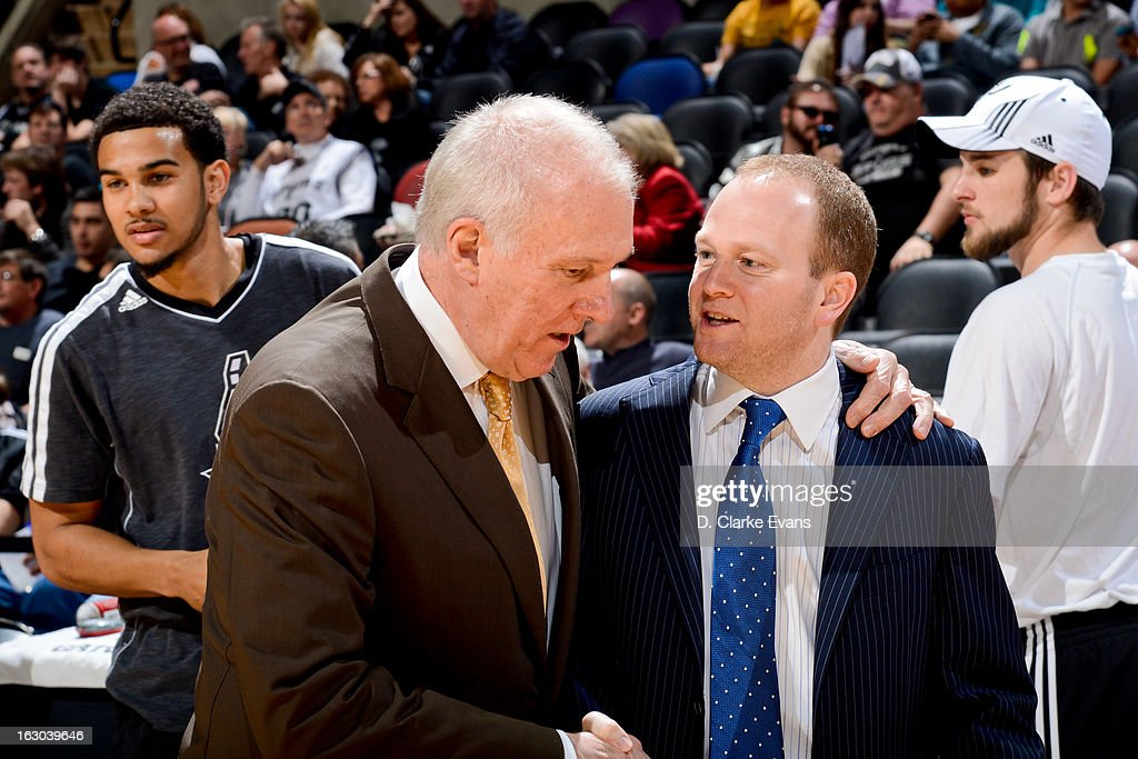 Head Coach Gregg Popovich of the San Antonio Spurs speaks with Head Coach Lawrence Frank of the Detroit Pistons before their game on March 3 2013 at...