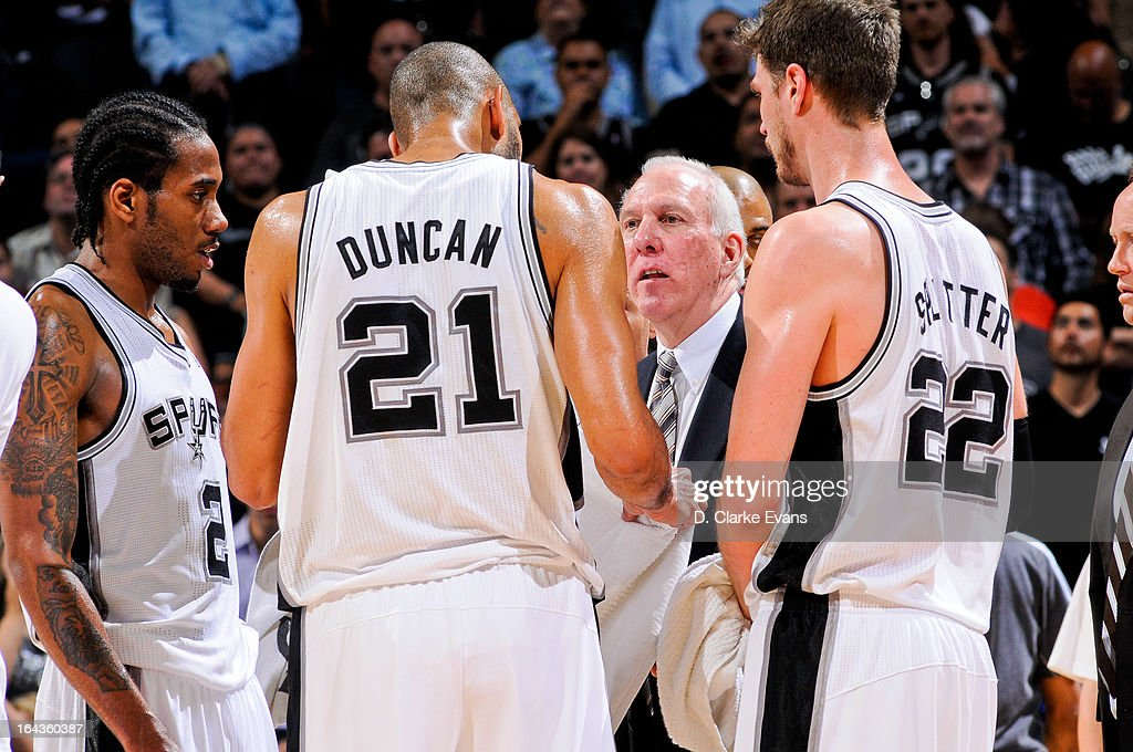 Head Coach Gregg Popovich of the San Antonio Spurs speaks with Kawhi Leonard #2, Tim Duncan #21 and Tiago Splitter #22 during a game against the Utah Jazz on March 22, 2013 at the AT&T Center in San Antonio, Texas. The team's victory resulted in Popovich's 900th career win.