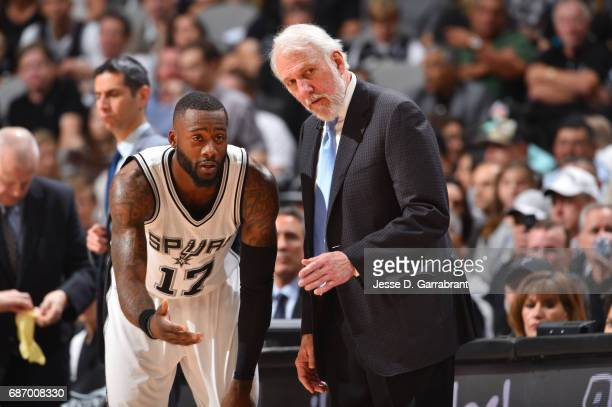 Head Coach Gregg Popovich of the San Antonio Spurs talks to Jonathon Simmons during Game Four of the Western Conference Finals of the 2017 NBA...
