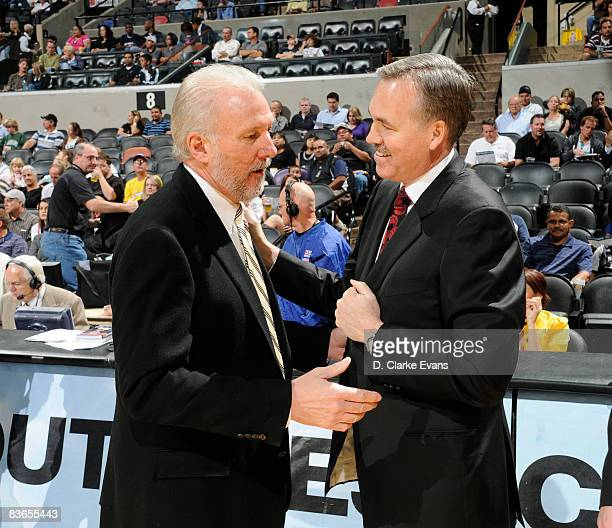 Head Coach Gregg Popovich of the San Antonio Spurs talks with Head Coach Mike D'Antoni of the New York Knicks on November 11 2008 at the ATT Center...