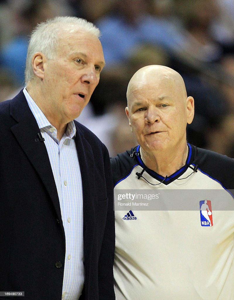 Head coach Gregg Popovich of the San Antonio Spurs talks with referee Joe Crawford #17 in the first quarter during Game Three of the Western Conference Finals of the 2013 NBA Playoffs at the FedExForum on May 25, 2013 in Memphis, Tennessee.