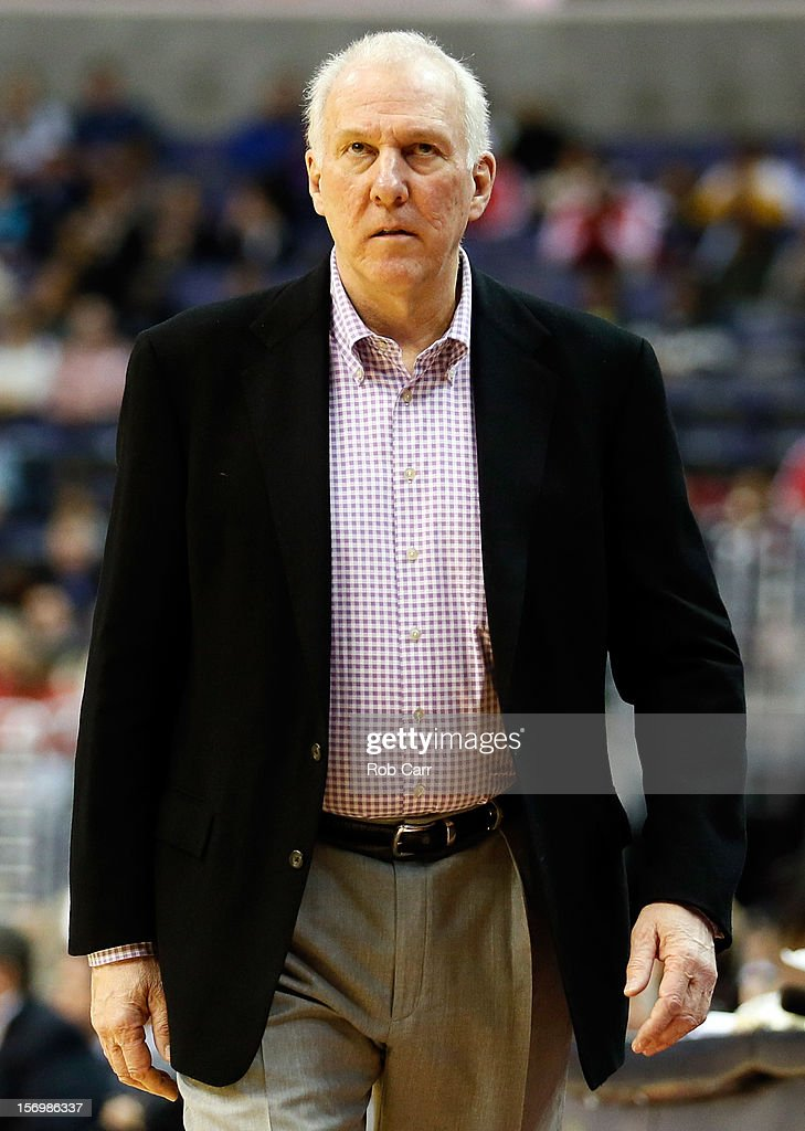 Head coach <a gi-track='captionPersonalityLinkClicked' href=/galleries/search?phrase=Gregg+Popovich&family=editorial&specificpeople=202904 ng-click='$event.stopPropagation()'>Gregg Popovich</a> of the San Antonio Spurs walks the sideline during the first half of the Suprs 118-92 win over the Washington Wizards at Verizon Center on November 26, 2012 in Washington, DC.