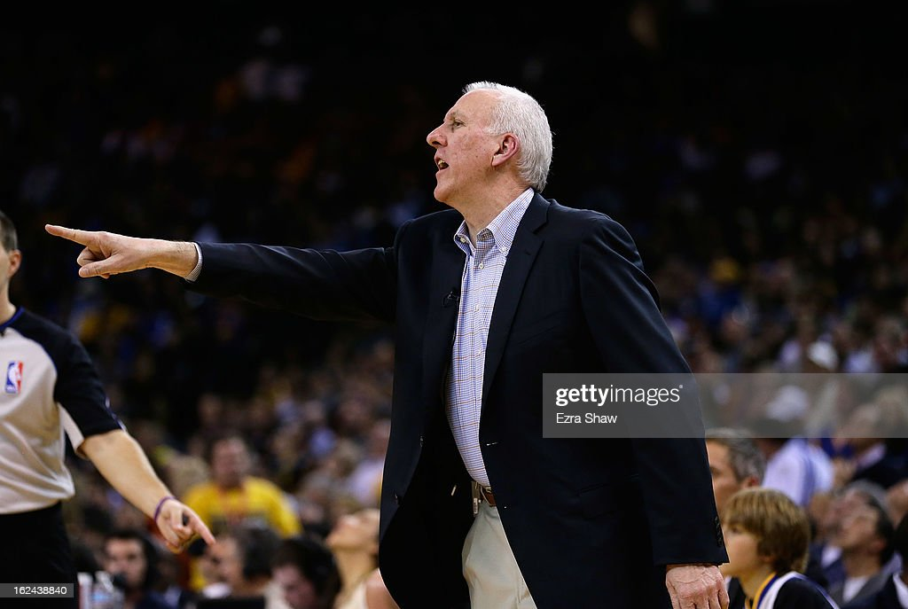 Head coach Gregg Popovich of the San Antonio Spurs yells to his team during their game against the Golden State Warriors at Oracle Arena on February 22, 2013 in Oakland, California. The Warriors are wearing new short-sleeved uniforms for the first time. The Warriors won the game in overtime.