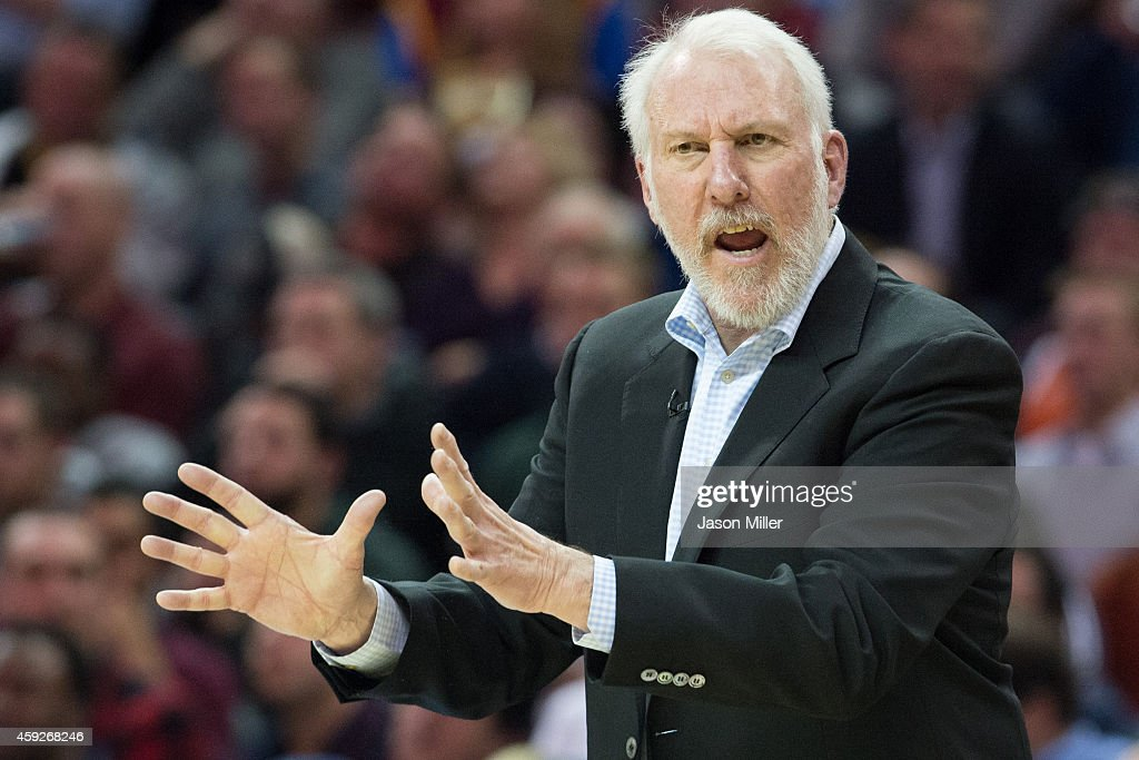Head coach <a gi-track='captionPersonalityLinkClicked' href=/galleries/search?phrase=Gregg+Popovich&family=editorial&specificpeople=202904 ng-click='$event.stopPropagation()'>Gregg Popovich</a> of the San Antonio Spurs yells to his players during the second half against the Cleveland Cavaliers at Quicken Loans Arena on November 19, 2014 in Cleveland, Ohio. The Spurs defeated the Cavs 92-90. User expressly acknowledges and agrees that, by downloading and or using this photograph, User is consenting to the terms and conditions of the Getty Images License Agreement.