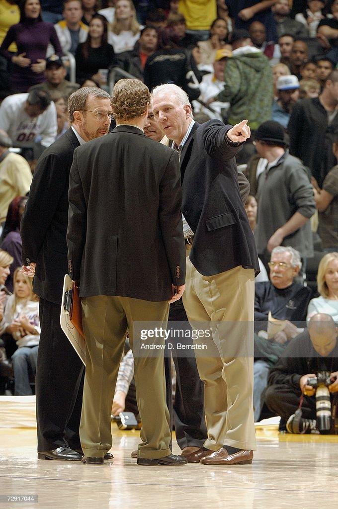 Head coach Gregg Popovich speaks with assistant coaches Don Newman, Mike Budenholzer and P.J. Carlesimo of the San Antonio Spurs during the NBA game against the Los Angeles Lakers at Staples Center on December 10, 2006 in Los Angeles, California. The Grizzlies won 106-99.
