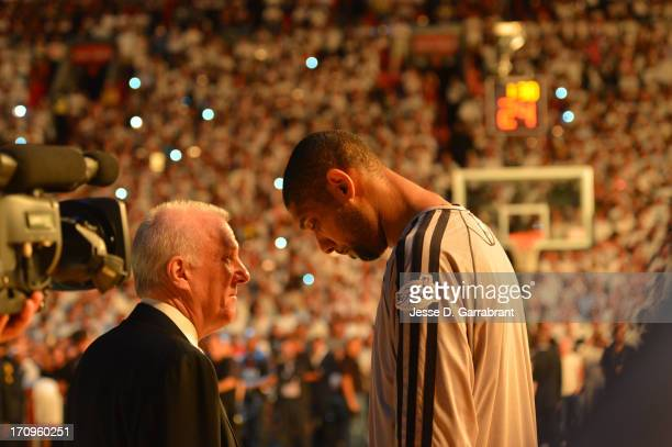 Head Coach Gregg Popovich talks Tim Duncan of the San Antonio Spurs before the game against the Miami Heat prior to Game Seven of the 2013 NBA Finals...
