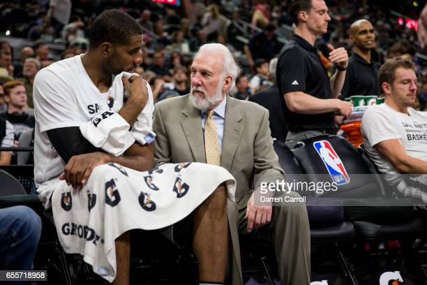 Head Coach Gregg Popovich talks with LaMarcus Aldridge of the San Antonio Spurs during the game against the Sacramento Kings on March 19 2017 at the...