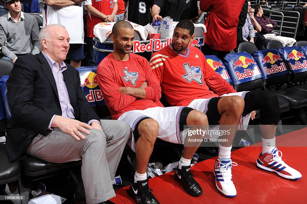 Head coach <a gi-track='captionPersonalityLinkClicked' href=/galleries/search?phrase=Gregg+Popovich&family=editorial&specificpeople=202904 ng-click='$event.stopPropagation()'>Gregg Popovich</a>, Tony Parker #9 and <a gi-track='captionPersonalityLinkClicked' href=/galleries/search?phrase=Tim+Duncan&family=editorial&specificpeople=201467 ng-click='$event.stopPropagation()'>Tim Duncan</a> #21 of the San Antonio Spurs sit on the bench during the game against the Los Angeles Clippers at Staples Center on February 18, 2012 in Los Angeles, California.
