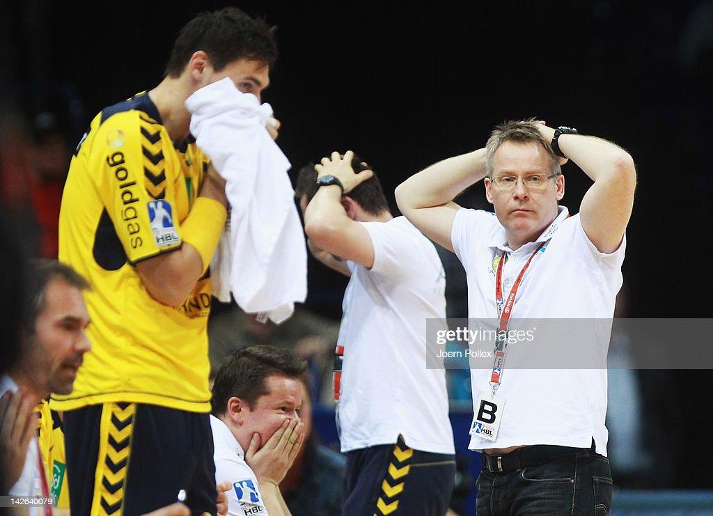 Head coach Gudmundur Gudmundsson (R) of Rhein-Neckar Loewen gestures during the Toyota Bundesliga handball game between HSV Hamburg and at the O2 World on April 10, 2012 in Hamburg, Germany.