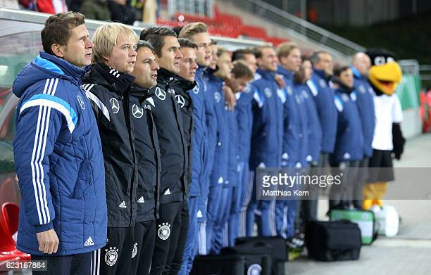 Head coach Guido Streichsbier of Germany and his team look on prior to the U20 international friendly match between Germany and Poland at Stadion...