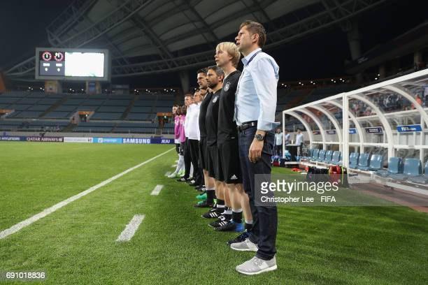 Head Coach Guido Streichsbier of Germany stands and sings their national anthem with his team during the FIFA U20 World Cup Korea Republic 2017 Round...