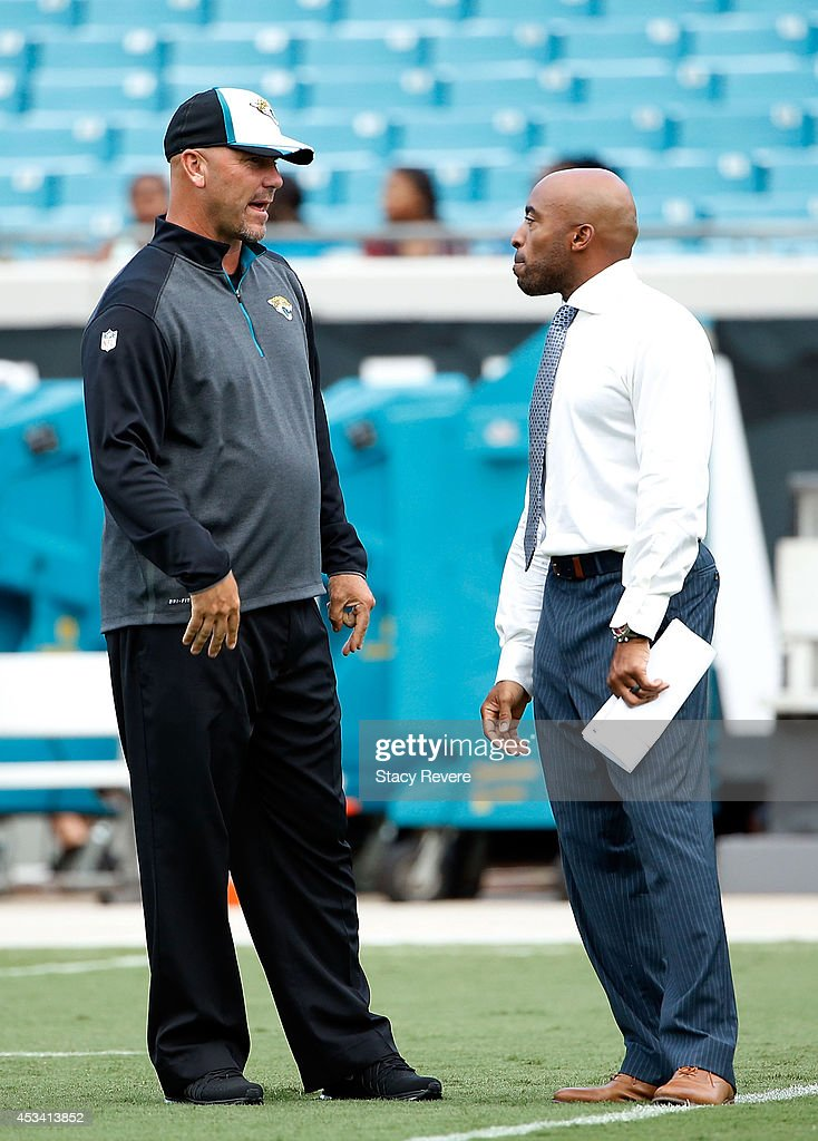 Head coach Gus Bradley of the Jacksonville Jaguars speaks with former player and television analyst Ronde Barber prior to a preseason game against the Tampa Bay Buccaneers at EverBank Field on August 8, 2014 in Jacksonville, Florida.