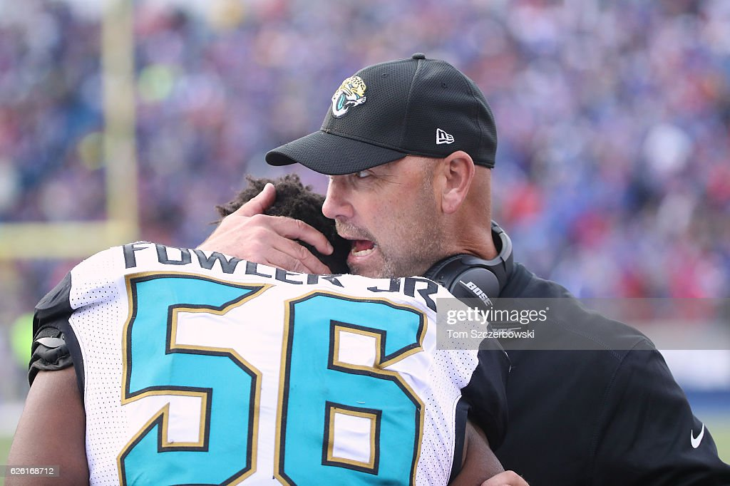 Head coach Gus Bradley of the Jacksonville Jaguars talks to Dante Fowler Jr. #56 during NFL game action against the Buffalo Bills at New Era Field on November 27, 2016 in Orchard Park, New York.