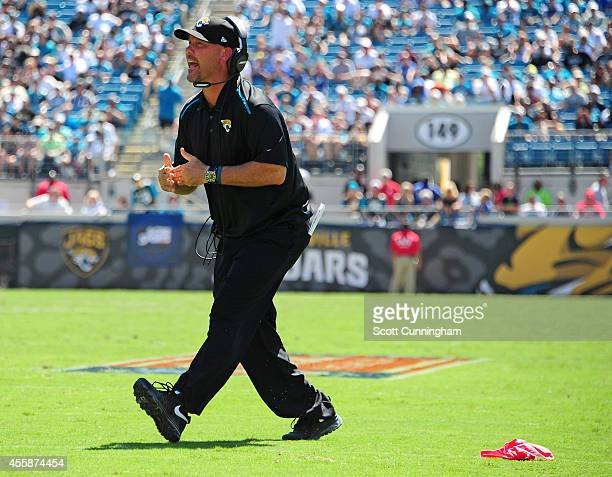 Head Coach Gus Bradley of the Jacksonville Jaguars throws the challenge flag against the Indianapolis Colts at EverBank Field on September 21 2014 in...