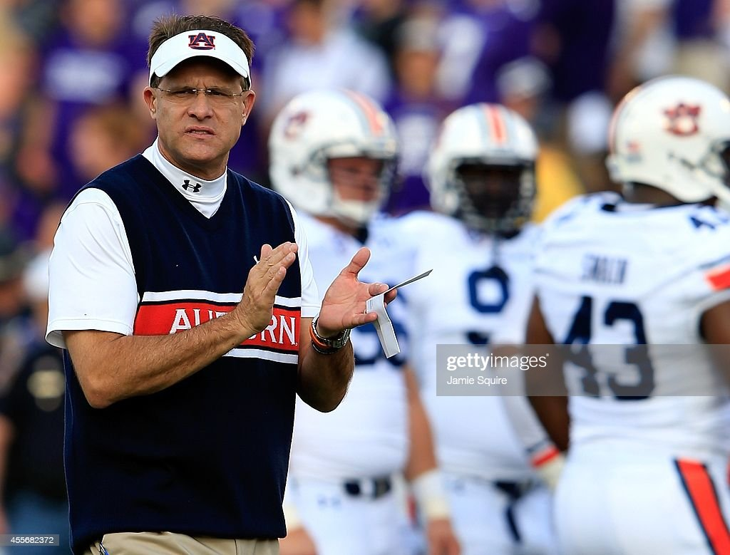 Head coach Gus Malzahn of the Auburn Tigers watches pregame warmups prior to the game against the Kansas State Wildcats at Bill Snyder Family...