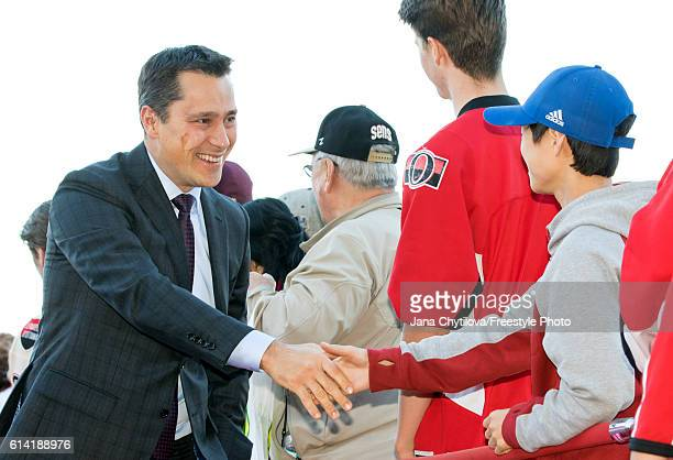 Head Coach Guy Boucher of the Ottawa Senators arrives on the red carpet prior to the start of the home opener against the Toronto Maple Leafs at...