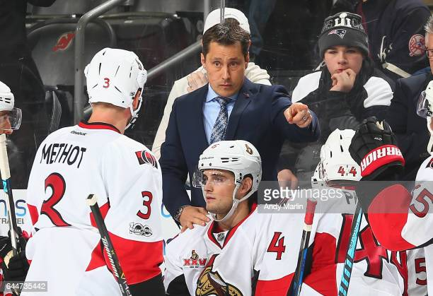 Head coach Guy Boucher of the Ottawa Senators gives instructions against the New Jersey Devils at Prudential Center on February 21 2017 in Newark New...