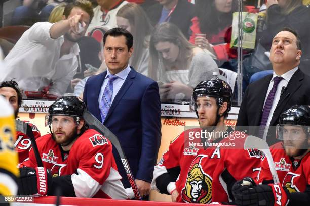 Head coach Guy Boucher of the Ottawa Senators looks on against the Pittsburgh Penguins in Game Three of the Eastern Conference Final during the 2017...