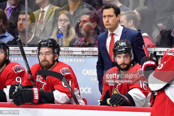 Head coach Guy Boucher of the Ottawa Senators looks on against the Pittsburgh Penguins in Game Six of the Eastern Conference Final during the 2017...
