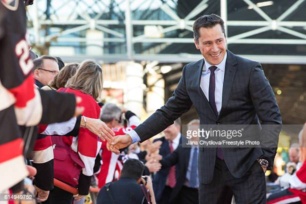 Head coach Guy Boucher of the Ottawa Senators walks the red carpet prior to their home opener against the Toronto Maple Leafs at Canadian Tire Centre...