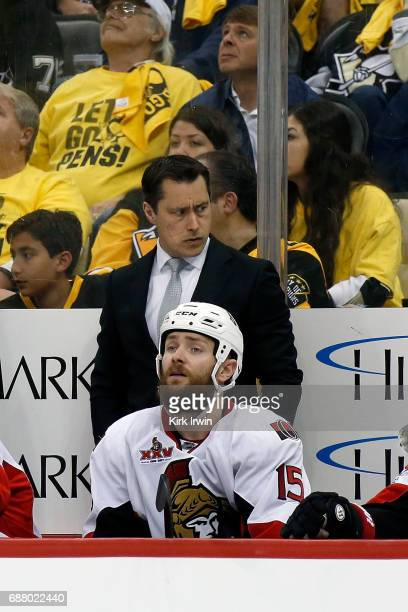Head coach Guy Boucher of the Ottawa Senators watches while his team takes on the Pittsburgh Penguins in Game Five of the Eastern Conference Final...