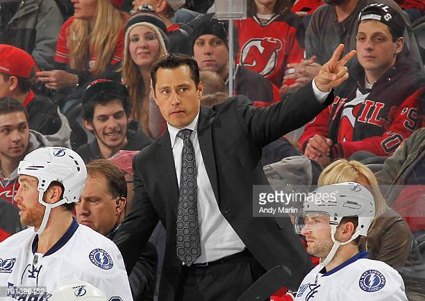 Head coach Guy Boucher of the Tampa Bay Lightning gives instructions against the New Jersey Devils during the game at the Prudential Center on...