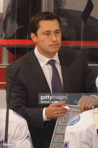 Head coach Guy Boucher of the Tampa Bay Lightning looks on during a NHL hockey game against the Washington Capitals on October 10 2011 at the Verizon...