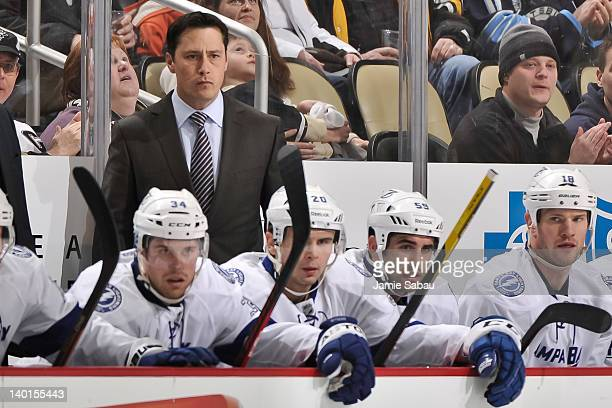 Head Coach Guy Boucher of the Tampa Bay Lightning watches his team play against the Pittsburgh Penguins on February 25 2012 at CONSOL Energy Center...